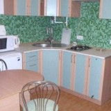 Kitchen with Microwave, electric kettle, toaster, refrigerator and Dinner table