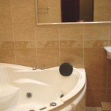 Renovated Bathroom with Jacuzzi There is a bide with toilet in separate room Washing-machine, Iron and Hair dryer