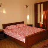 Bedroom with a King-size bed and a wardrobe